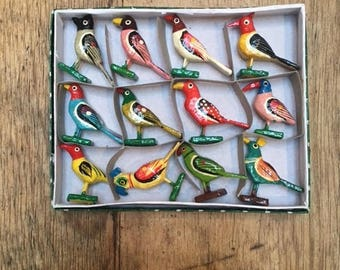 A boxed set of 12 hand carved and painted birds from India