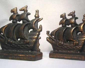An Antique Pair of Arts and Crafts Cast Iron Bookends A3
