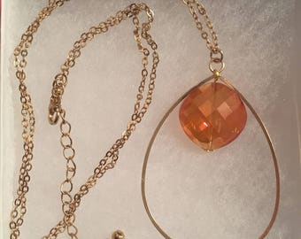 Gold teardrop necklace with jewel centre