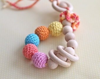Teething toy rattle with crochet wooden beads and 3 wooden rings. Yellow, orange, aqua blue/ cyan, coral.