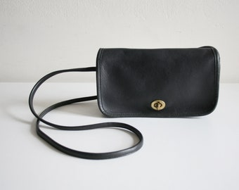 Blackish Navy Coach Dinky Penny Satchel