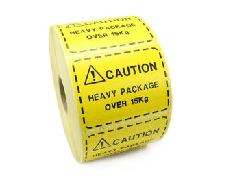Caution Heavy Package over 15kg. Bright Yellow Shipping Labels / stickers. Bright Warning labels ideal for Boxes & packages.