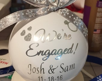 """Personalized  White  """"We're Engaged!"""" dated Christmas Ornament"""