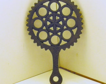Black Cast Iron pot holder trivet gear circle and star pattern