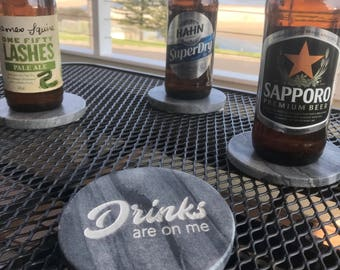 Laser engraved marble coasters Drinks Are On Me