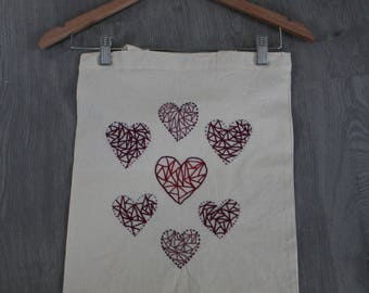Tote bag embroidered hand motif in shades of Red hearts