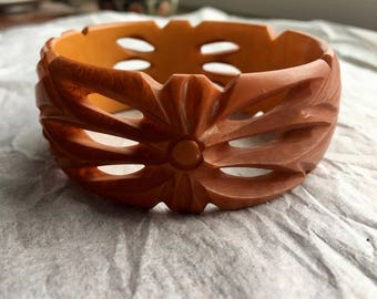 Pierced and Deeply Carved Butterscotch Bakelite Bangle