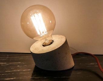 Leaning rough concrete lamp