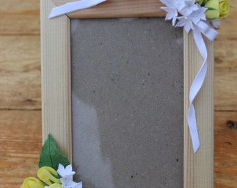 Frame with yellow roses