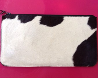 White and Black cow print fur wristlet