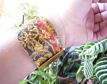 Bangle cuff with orange and Red rhinestones