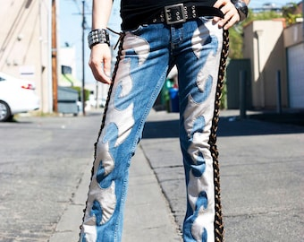 Faux Silver Leather Axe shape with side Gold Lace up on a pair of Vintage Blue Jeans