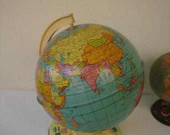 Vintage Metal Globe-Mid century Art World Globe with flag decoration on the base.