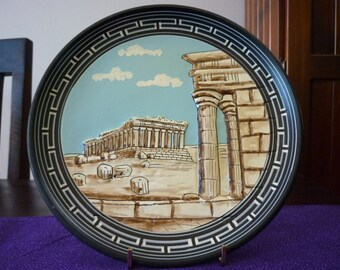 Grecian wall art. Decorative handmade plate with images of the Acropolis. Vintage design, kitsch home decor. Terracotta plate.