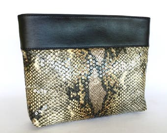 Essie Sequinned Clutch:  Clear round sequins on Snake Skin Print with Black leather trim