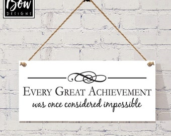 Every Great achievement was once considered impossible motivational quote sign