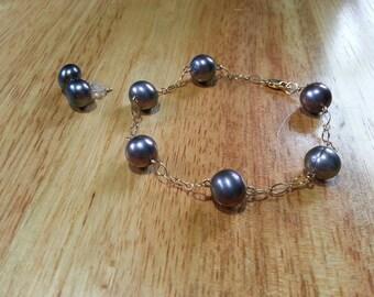 FW pearl link bracelet and stud earrings.