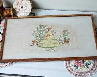 A beautiful embroidered needlepoint tray