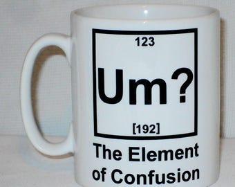 um the element of confusion mug