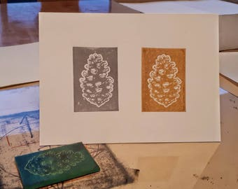 Pinecones in pewter and gold greeting card