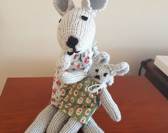 Hand knitted mummy and baby rabbits