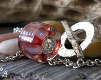 Pleasure Works. Sterling silver lined boro glass bead necklace. Red, salmon and brick. Handmade toggle clasp and quality 2mm rolo chain.