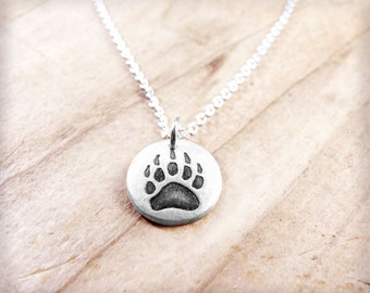 Tiny bear paw necklace in silver, bear paw print pendant