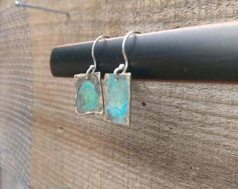 Hammered brass earrings with green patina
