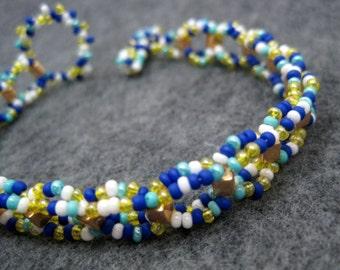 Beaded Bracelet - Multicolored Blue Yellow White Simple Fun by randomcreative on Etsy