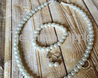 Pearl necklace, bracelet, and earring set