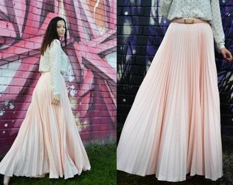 Light powder blush pink flowing floor length sunray pleated full circle maxi skirt.