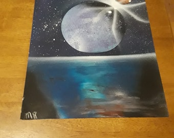 Planet & its moon crashing above the water spray paint art