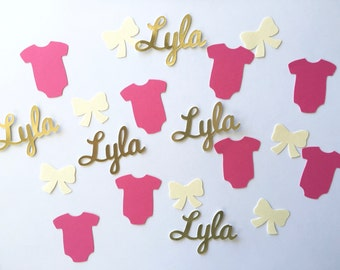 It's a Girl Baby Shower Confetti  250 pieces including pink bodysuits and white or ivory bows.  Custom, personalized name confetti
