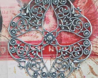 Round filigree brass stamping with four petals, Sterling silver finish, Made in the USA