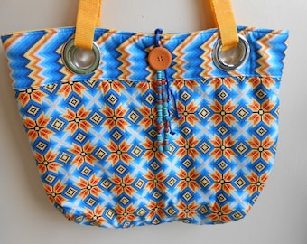 Large Sourhwestern grommet handbag