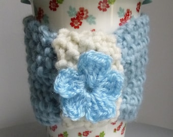 Floral ceramic travel mug with pure wool blue cozie
