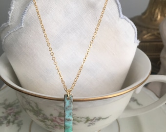 Gold tone With turquoise vertical metal bar on gold tone Necklace