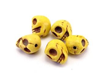 Set of 5 skulls yellow howlite