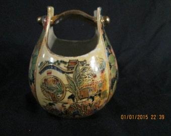 A unique Cloisonne basket or vase