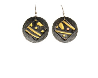 Sterling silver textured earrings with mixed metal insert.