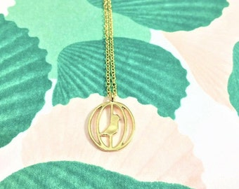 Gold bird in a cage pendant necklace