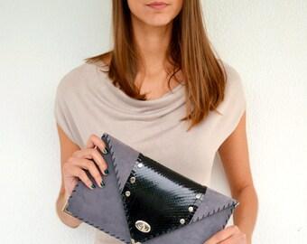 Grey leather clutch with genuine black snakeskin