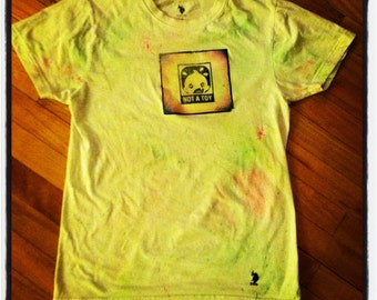 Pumpkin-baby Says NO- hideous-paint-splatter T-shirt. Only 2 of these exist