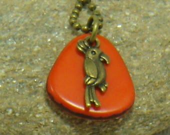The parrot on background pendant orange