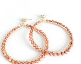 Gold hoop earrings with wire-wrapped coral colored Czech glass beads // statement earrings // large hoop earrings // gifts for her