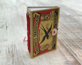 Matchbox Notebook with red embroidery thread and button closure