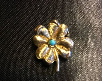 Flower Brooch with Turquoise looking center . . .
