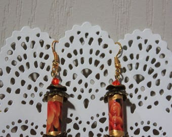 Pair of orange earrings