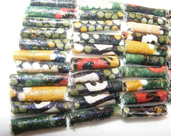 She's in our corner. We weren't sure until she gave us the sparkle detail. Then we were sure. Fabric Beads, textile art bead, Australian