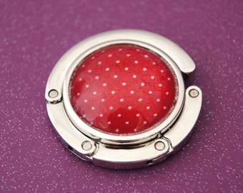 Bag hanger with red dots